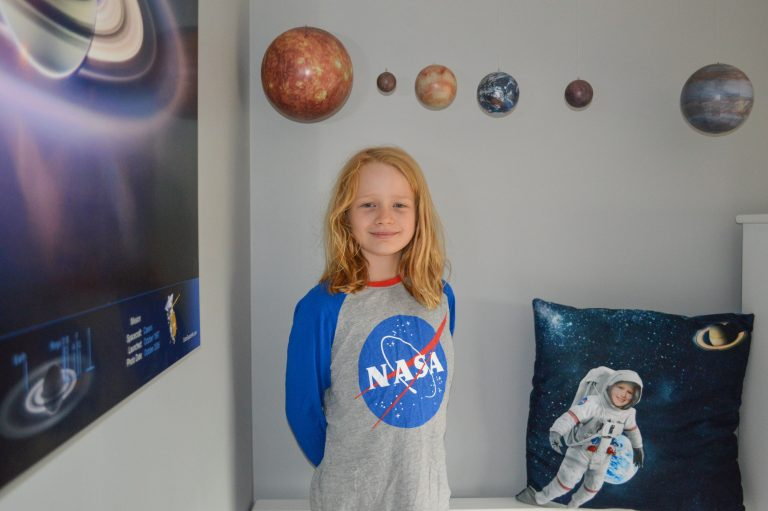 Lily, age 9, in a NASA shirt