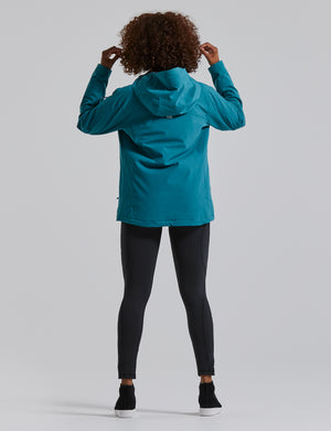 Woman wearing the Endeavour Jacket, color:Spruce Heather