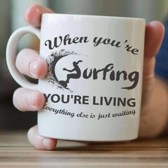 """When You're Surfing, You're Living"" Mug"