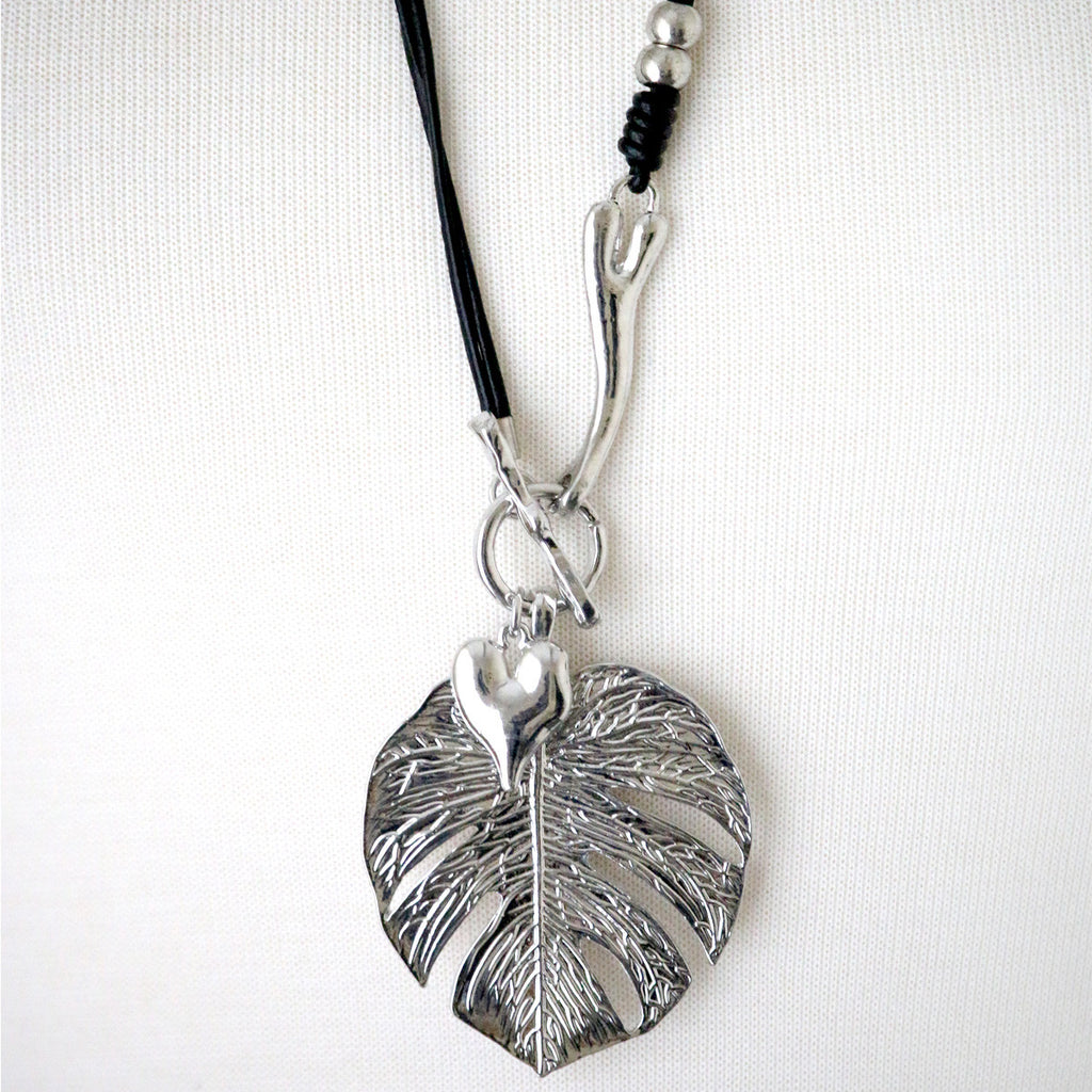 Metal leaf and heart charm necklace