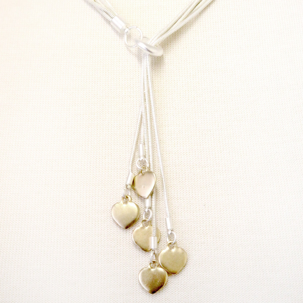 Snake chain necklace with dangly gold hearts necklace