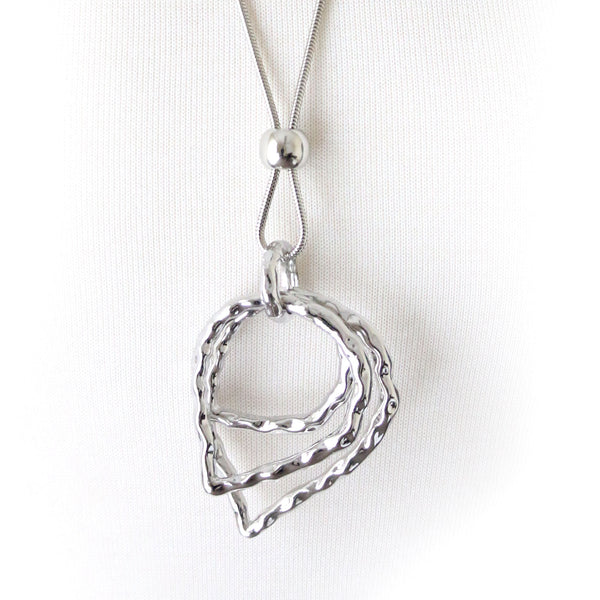 Abstract design necklace with ornate T-Bar opening