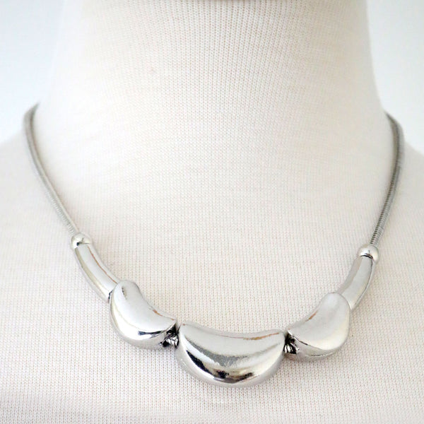 Solid Metal crescent nugget Necklace in a polished finish
