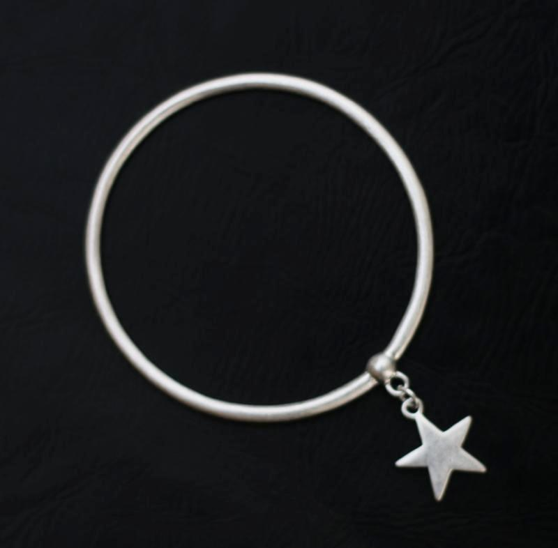 Contemporary bangle with star charm by Sarah Tempest