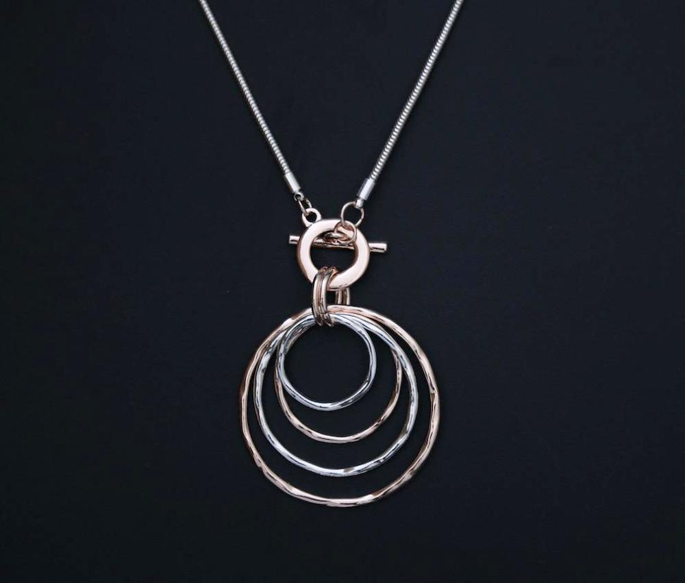 Abstract circles pendant on long chain necklace in silver and rose gold  by Sarah Tempest.