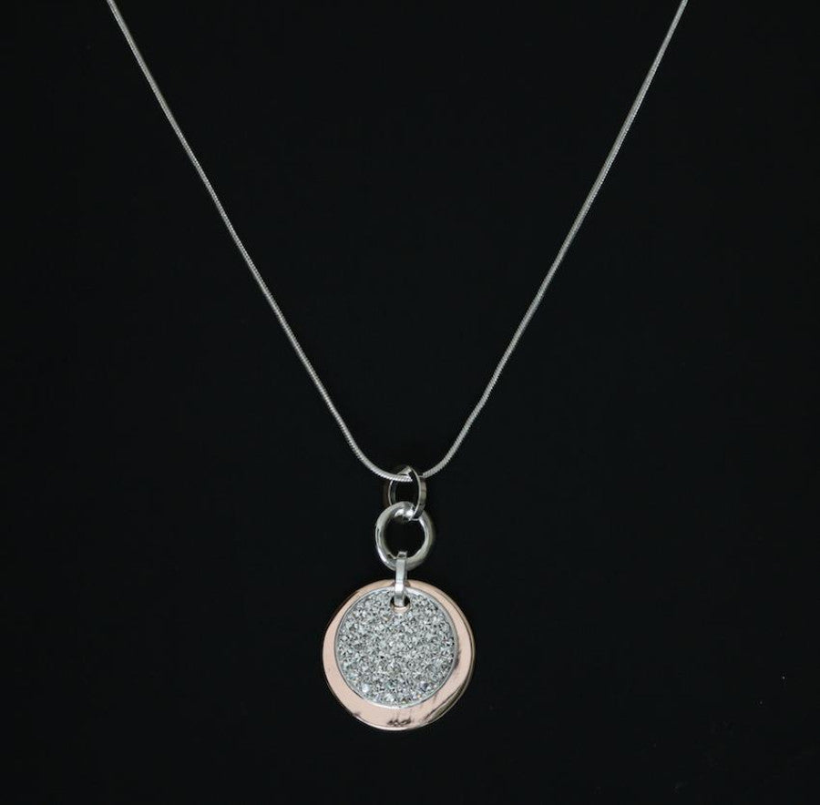 Crystal Disc Pendant Necklace in silver and rose gold made and designed by Sarah Tempest.