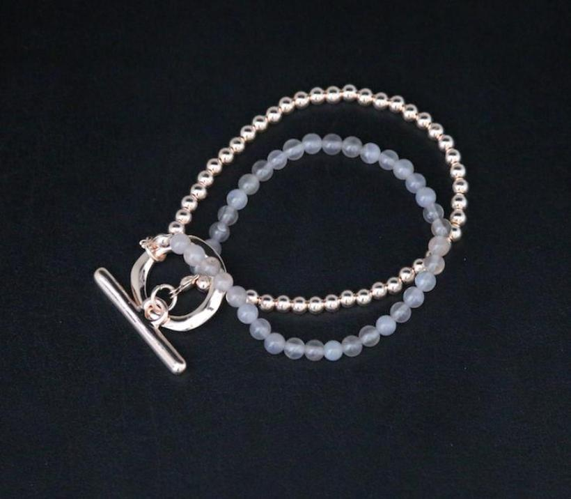Double strand bracelet in  grey Agate beads and rose gold with T bar clasp by Sarah Tempest.