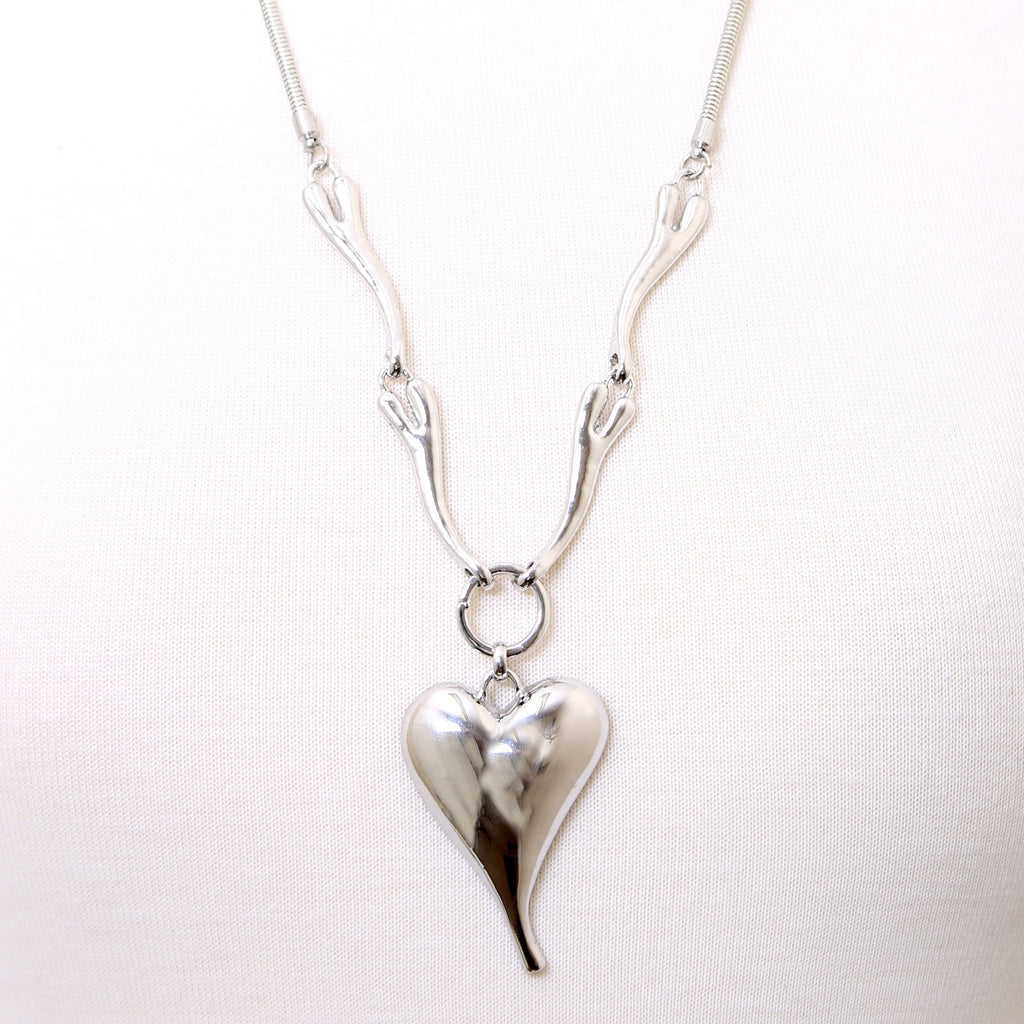 Highly polished metal heart pendant necklace