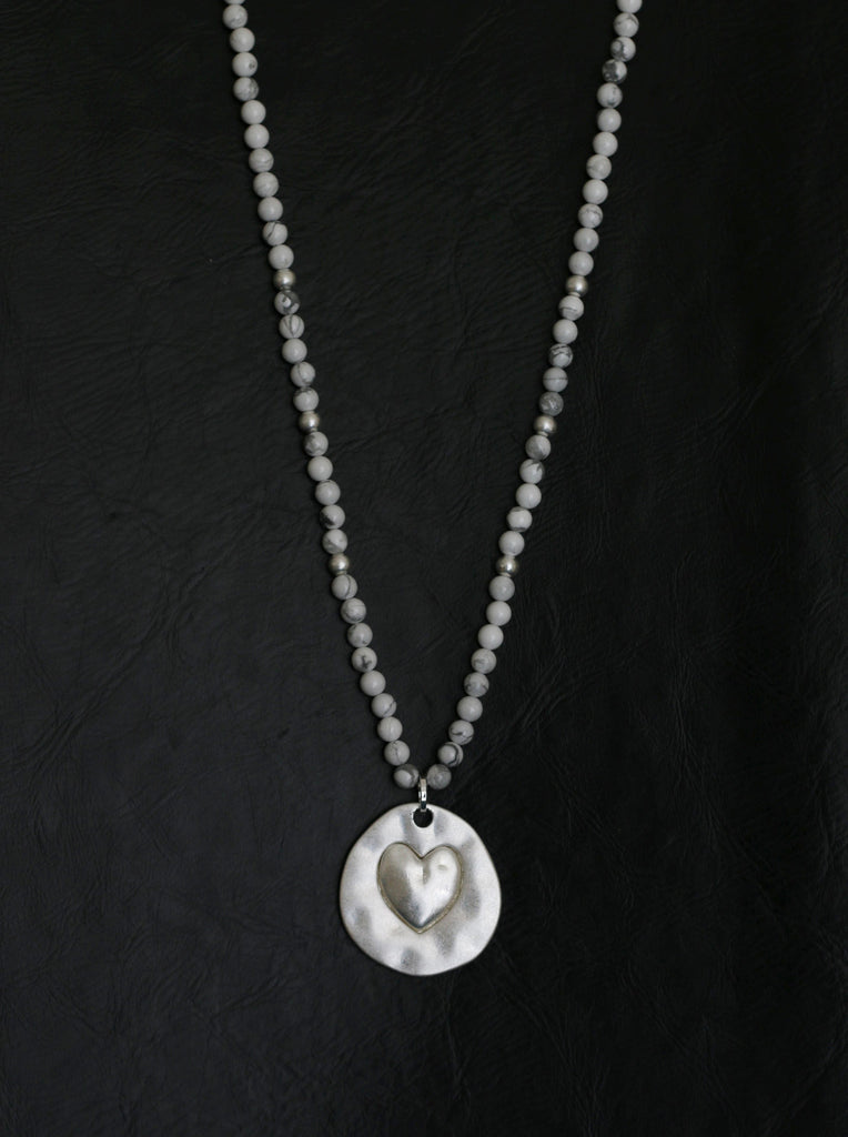 Howlite long beaded necklace with heart impression pendant designed by Sarah Tempest