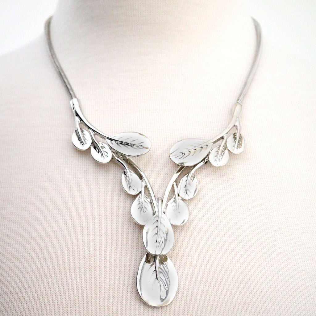Large statement silver coloured  metal leaf necklace on a snake chain