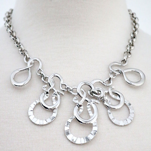 Abstract Swirl design statement Necklace on a belcher chain