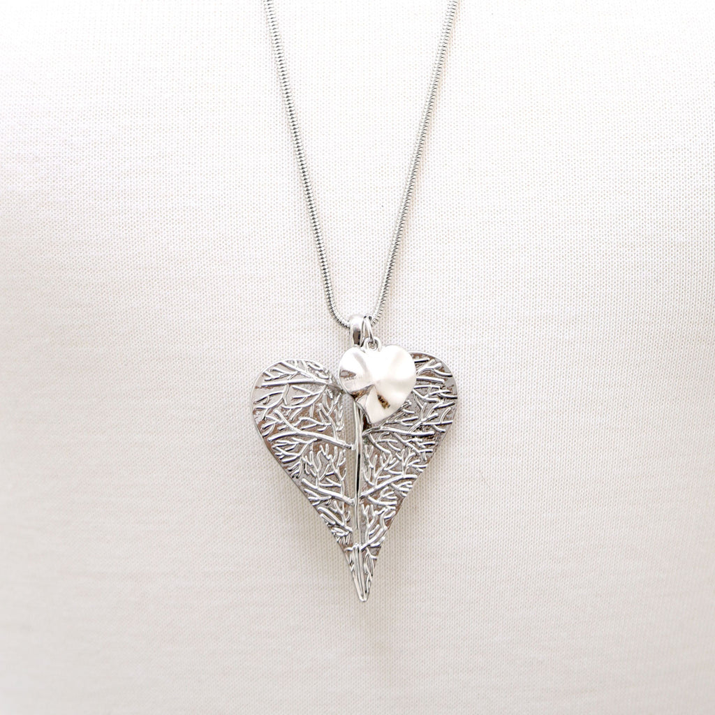 Leaf design pendant with heart charm on a snake chain necklace