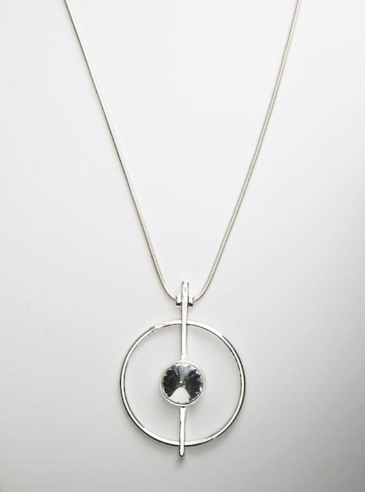 Open Silver Circle Pendant with Crystal Centre on a Long Snake Chain Necklace by Sarah Tempest.