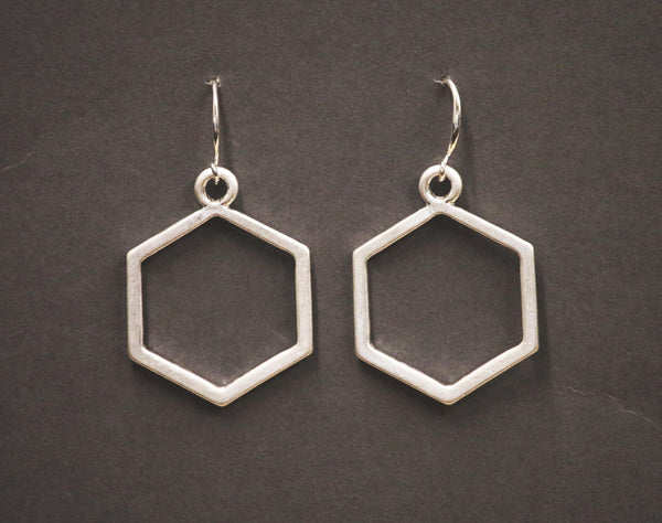 Open hexagon shape fish hook earrings by Sarah Tempest