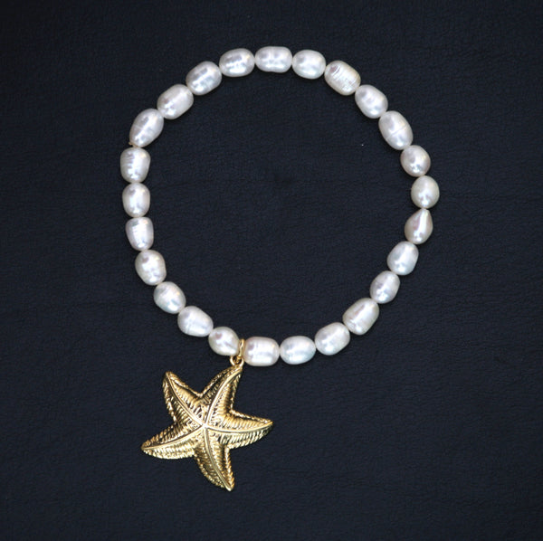 Real pearl Beaded Stretchy Bracelet with starfish charm by Sarah Tempest.