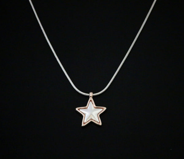 Short snake chain silver necklace with star pendant designed by Sarah Tempest.