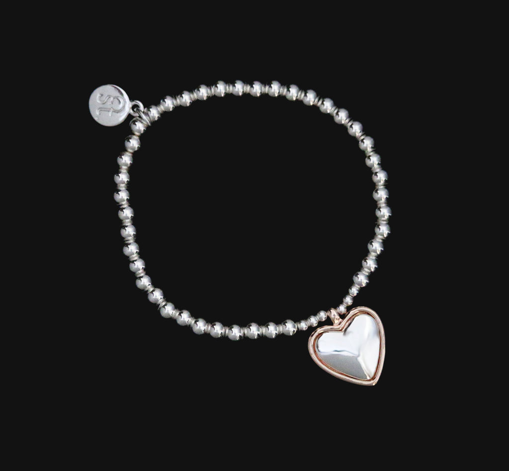 Stretchy beaded bracelet with heart charm by Sarah Tempest.