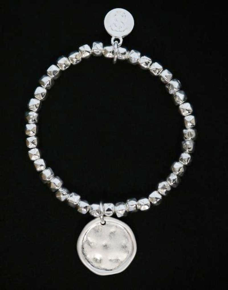 Stretchy beaded bracelet with soft hammered disc charm by Sarah Tempest
