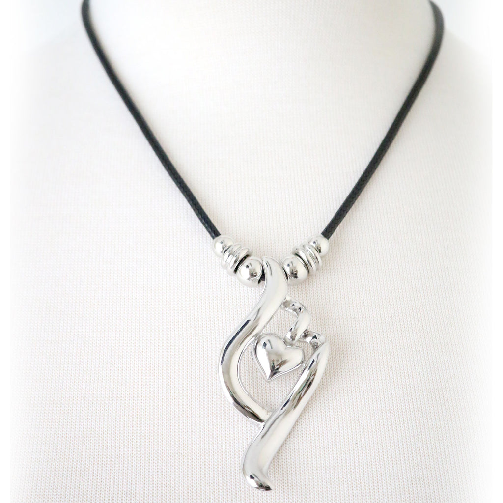 Twirly heart pendant on a black waxed cord necklace