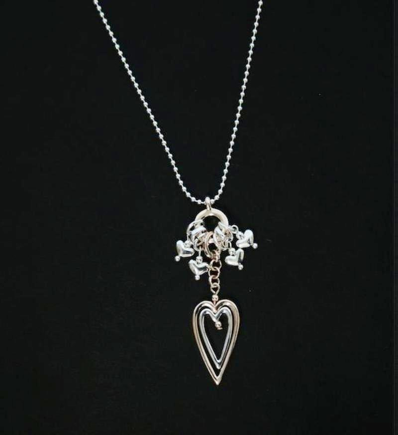 Two tone open heart pendant necklace designed and made by Sarah tempest.