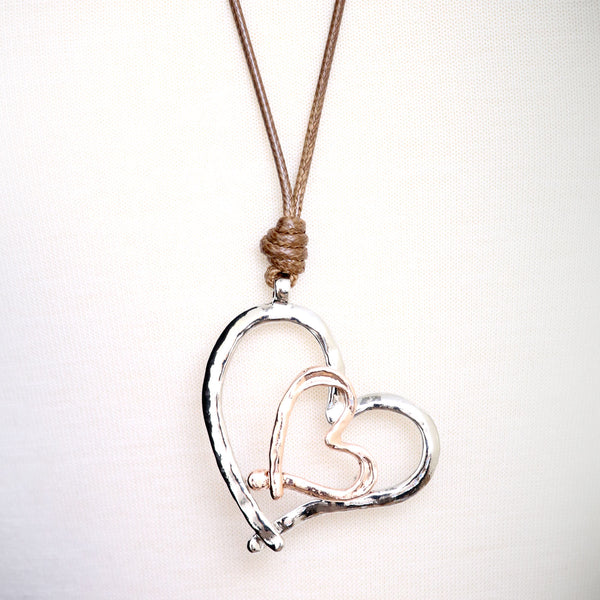 Abstract 2-tone heart pendant Necklace on a tan cord