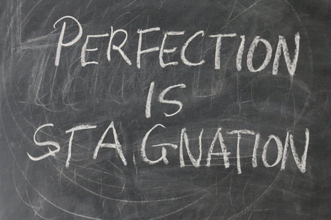 Perfection is Stagnation Written On Chalk Board