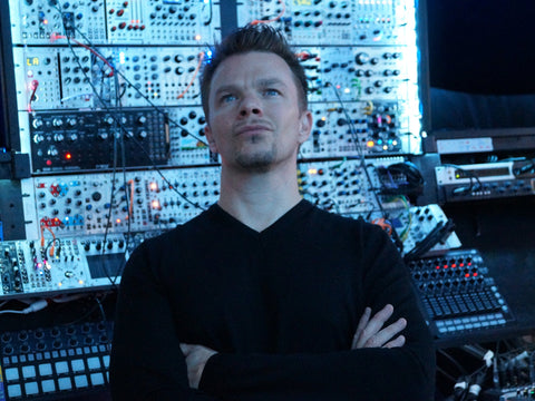 Attila Hanak in front of his modular synths in his studio