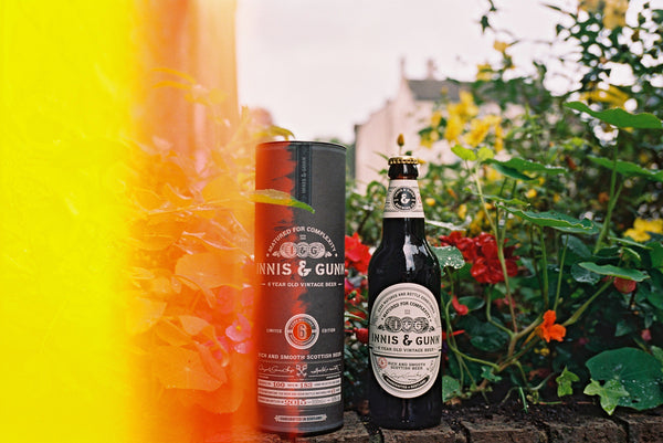Innis & Gunn Vintage beer photographed on a garden wall