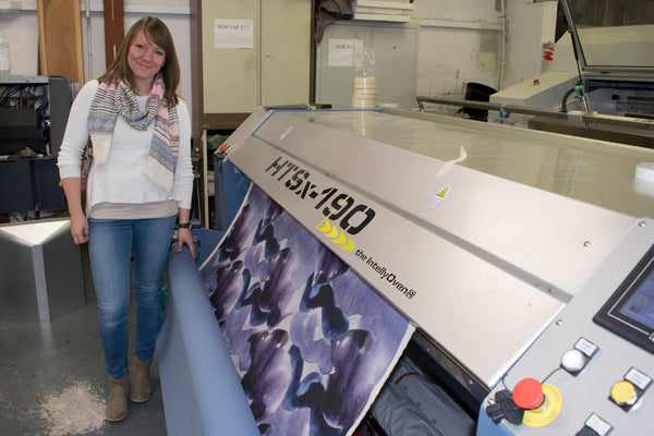 Designer Hannah Knapton at the digital printers in the North of England with her abstract stormy skies fabric design.
