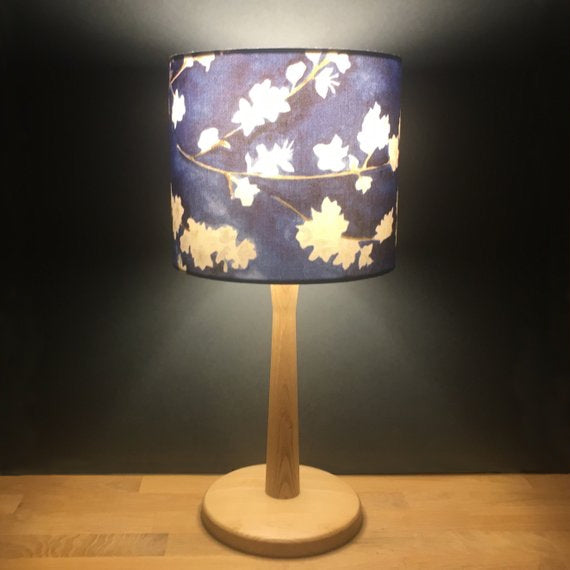 Midnight blossom 20cm drum lampshade in cotton satin with the light on