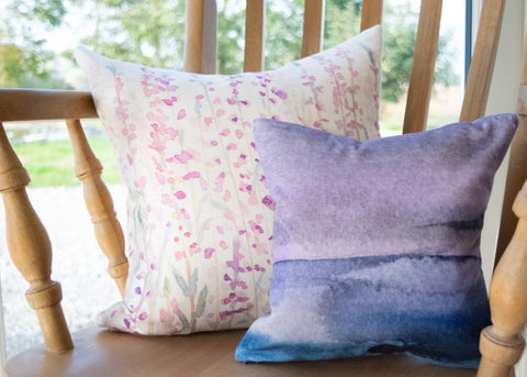 Small velvet moorland landscape cushion and linen/cotton heather cushion by Hannah Knapton