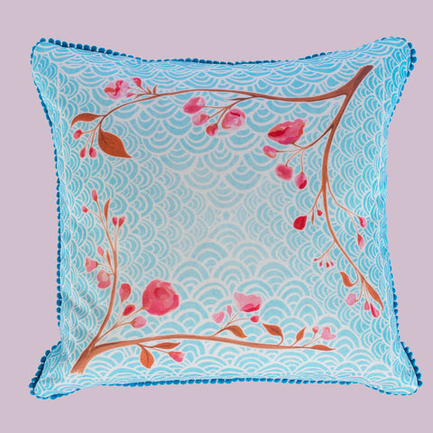 Pom Pom Oriental Blossom and Wave cushion by Hannah Knapton, in blue, pink, teal and white