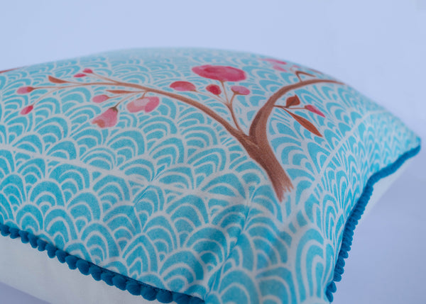 Side of pom pom oriental blossom cushion by Hannah Knapton