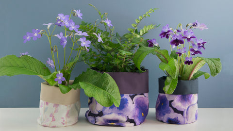 Hannah's waterproof fabric plant pots with heather and pansy designs