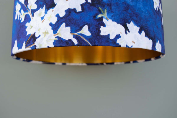 Gold lined 30cm drum pendant lampshade with Midnight Blossom print by Hannah Knapton