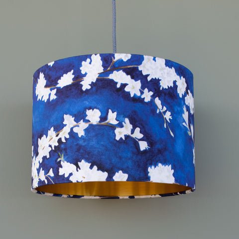 Gold lined 30cm drum midnight blossom pendant lampshade, designed and handmade by Hannah Knapton