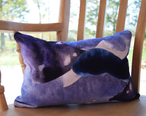 Velvet abstract stormy skies cushion by Hannah Knapton, 30x45cm, purple, blue and grey
