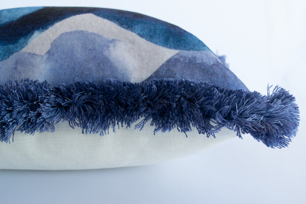 Detail of fringed stormy skies cushion by Hannah Knapton