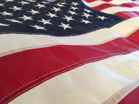 Close up of American Flag with sewn stripes and embroidered stars