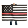 Black and white American flag with Thin Red Line being held by woman