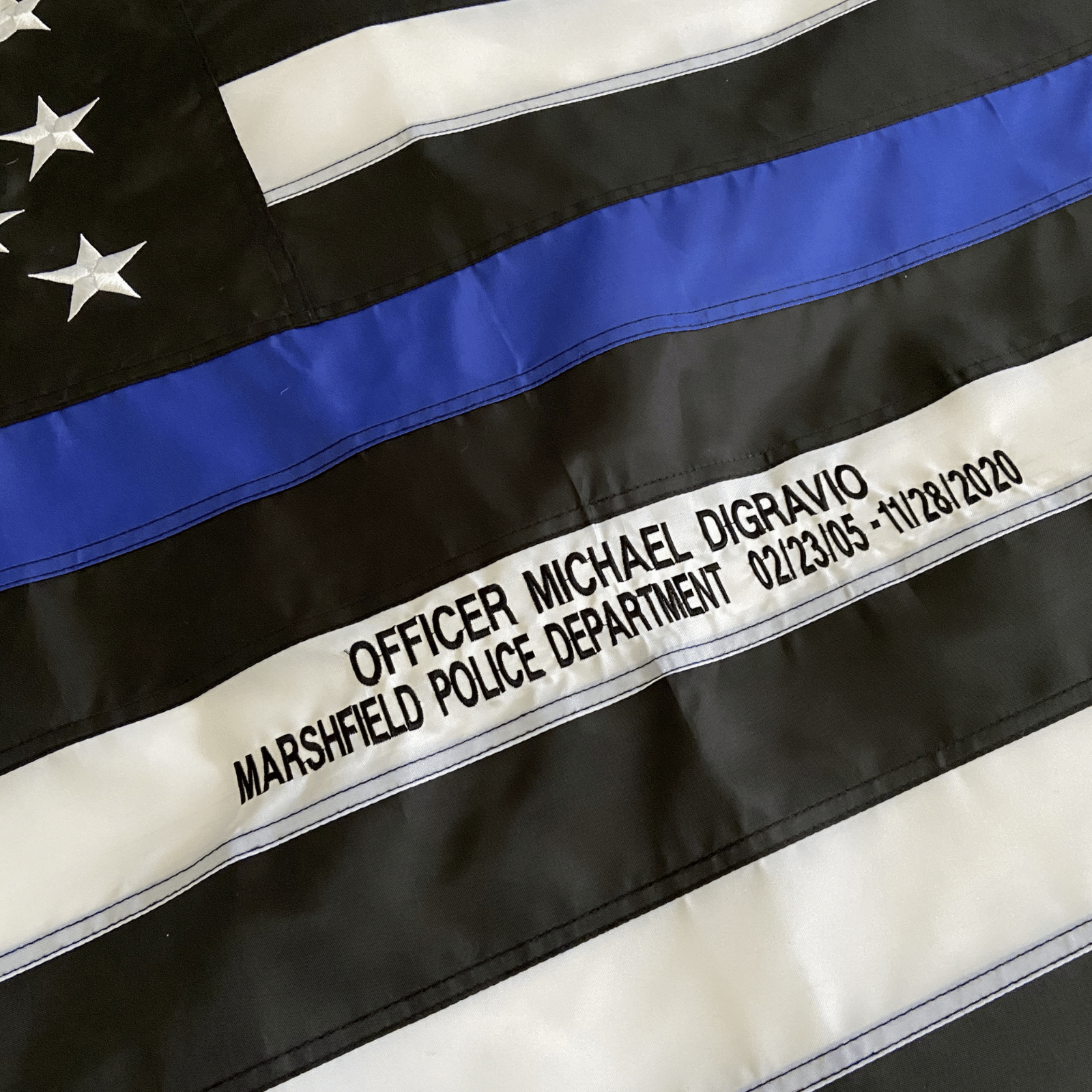 Custom Embroidery on Thin Blue Line Police Flag Officer Name and Badge