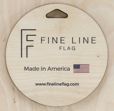 close up of built in hanger for wall display says mad in America by fine Line Flag
