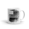 coffee mug with black and white American flag image smeared in a fingerprint