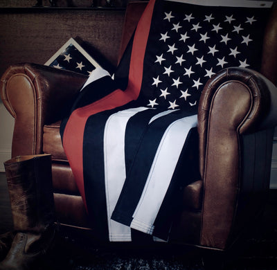 3x5 foot nylon firefighter flag resting on leather chair