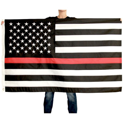 woman holding thin red line flag open