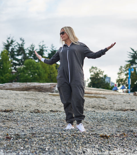 blond girl on beach in a onesie with butt flap