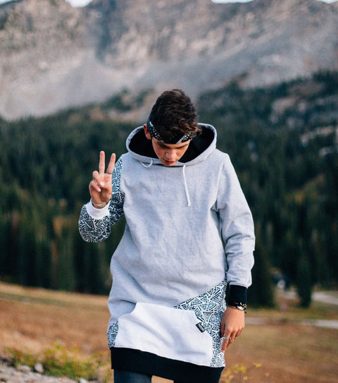 Our trendy hypno slash grey and black pull over hoodie with triangle print accents