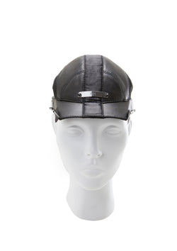 Leather cap with feather on the visor made by house of malakai