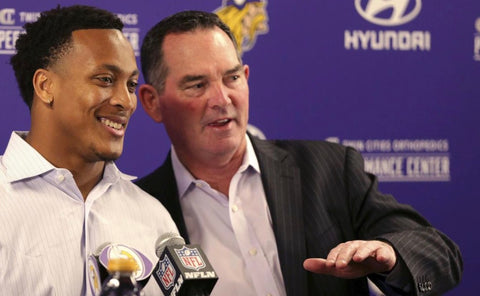 Minnesota Vikings head coach Mike Zimmer, right, introduces Mike Hughes during a news conference as the team's selection from the first round of the NFL football draft Friday, April 27, in Eagan, Minn. (AP Photo/Andy Clayton-King)