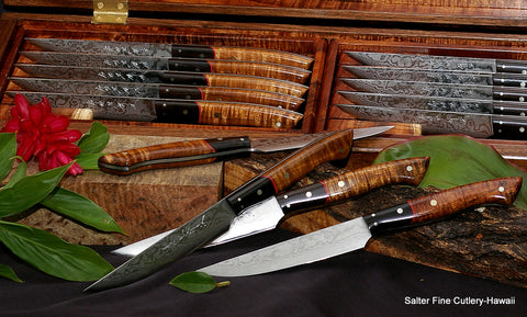Handmade steak knife set with decorative options of long ebony bolster and red accents